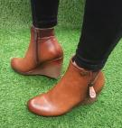 TAN WEDGE BOOT IS A MUST HAVE...........